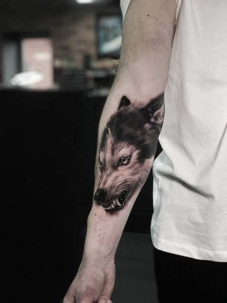 Wolf tattoo Artjom